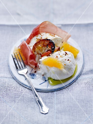 Burrata with thinly sliced speck and fresh and cooked clementines