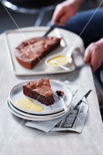 Serving chocolate cake with custard