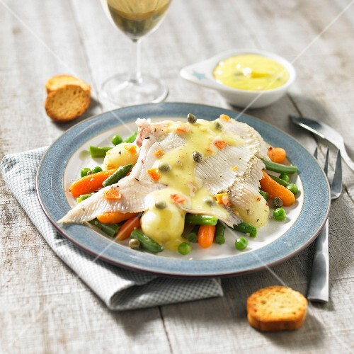 Skate wing in caper sauce and spring vegetables
