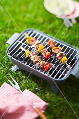 Grilling beef skewers on the barbecue outdoors