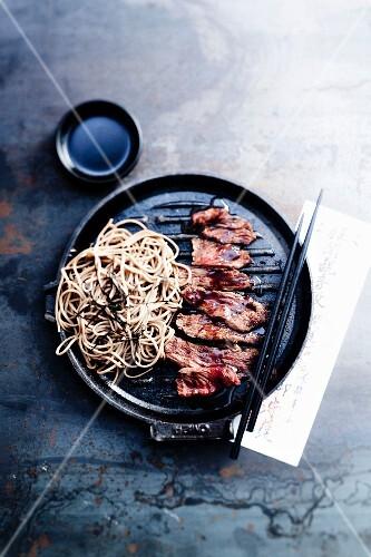 Yakiniku beef and Asian noodles with seaweed