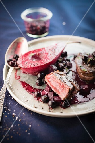 Doe tournedos,pear poached in red wine and beetroot-blackcurrant sauce