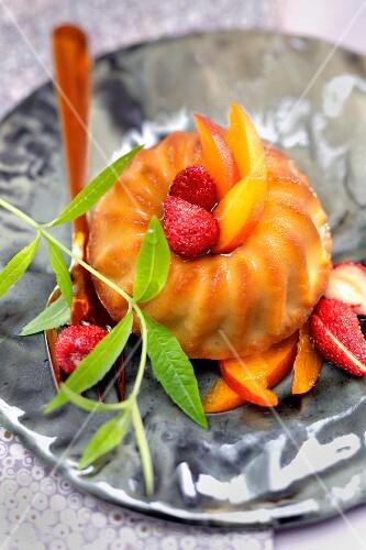 Small Rum Savarin with wild strawberries,apricots and verbana