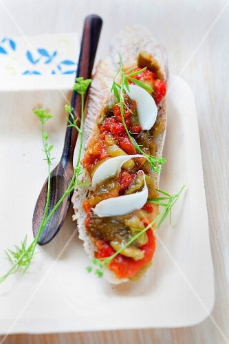 Stewed peppers and tomatoes with garlic on sliced bread