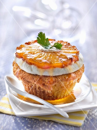 Financier topped with a caramelized pineapple slice and coriander