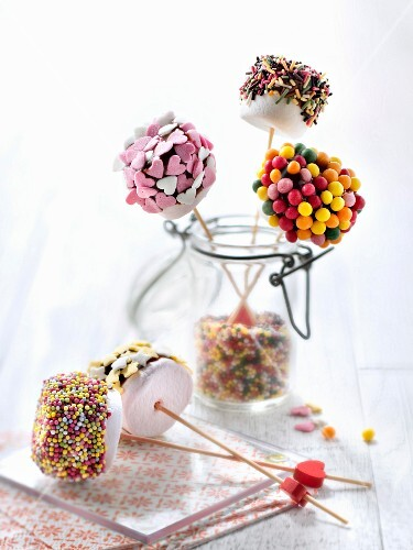 Chocolate coated marshmallows decorated with colored drops and vermicellis