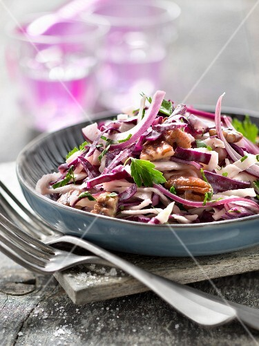 Red and white coleslaw with walnuts and maple syrup