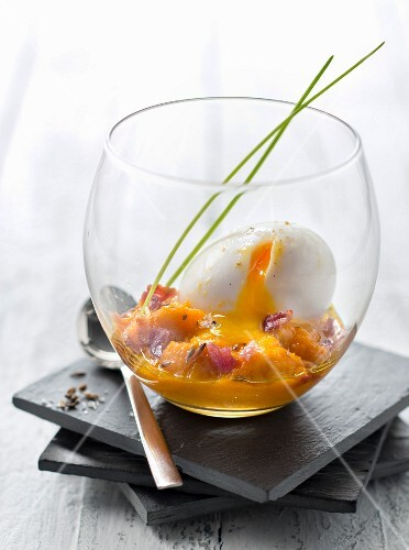 Soft-boiled egg with carrot purrée,cumin and crisp bacon