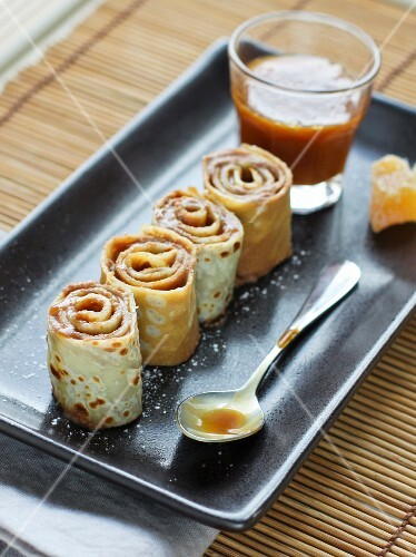 Pancake and chocolate mousse makis with toffee-ginger sauce