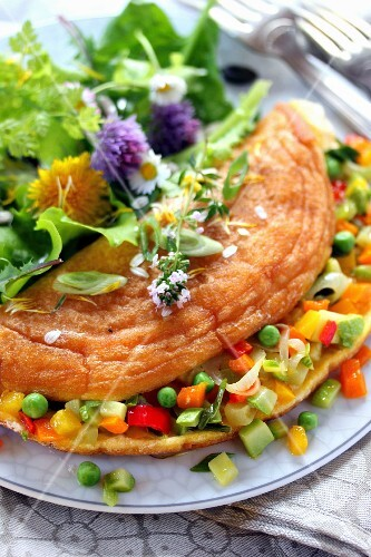 Diced vegetable omelette,sprout and flower salad