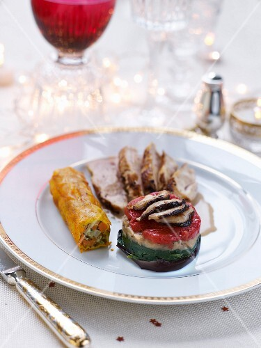 Roasted free-range capon,crispy old-fashioned vegetable roll and rocket lettuce,stewed tomato and eggplant layer
