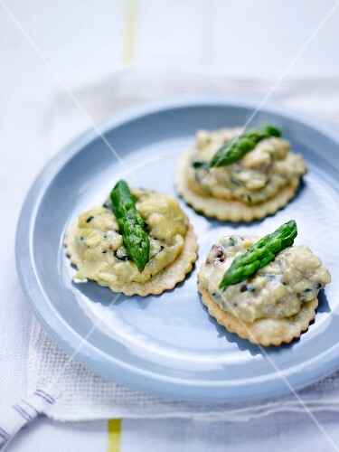 Scrambled eggs and green asparagus top on a parmesan shortbread canapés