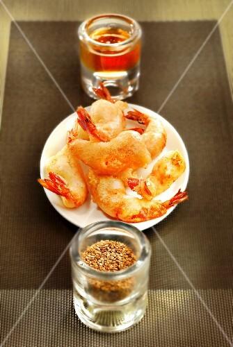 Shrimp fritter tapas with sesame seeds and honey
