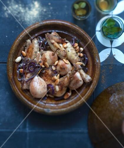 Chicken, pear, almond and red onion tajine