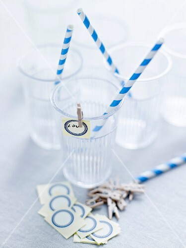 Plastic cups, striped straws and name tags