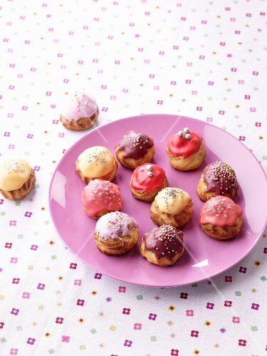 Lemon, raspberry, violet and blueberry cream puffs