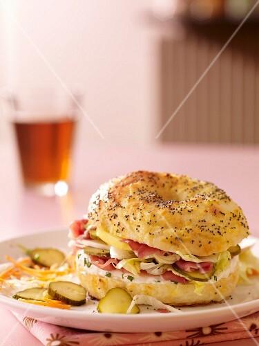 Raw ham, lettuce, apple and gherkin bagel
