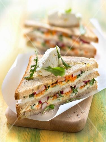 Vegetarian Philadelphia cheese, radish, rocket lettuce and carrot club sandwich