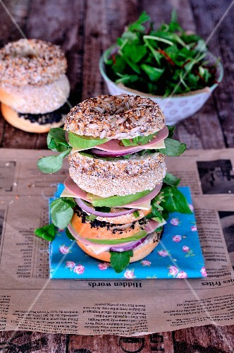 Chicken breast, avocado and mesclun seedy bagel sandwiches