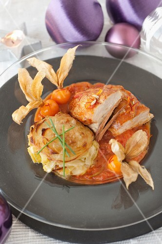 Spicy capon fillet with honey and physalis,leek and potato tian