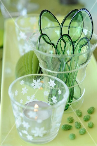 Green plastic cups and spoons