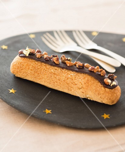 Chocolate Éclair topped with crushed pralines