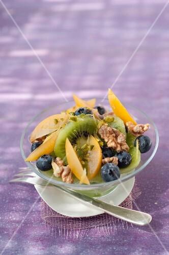 Kiwi,plum,blueberry,walnut,pistachio and honey fruit salad