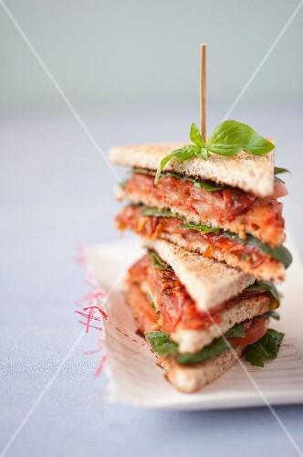 Two tomato and pesto club sandwiches