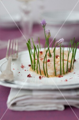 Langoustine and lychee tartare with pink peppercorns and chives