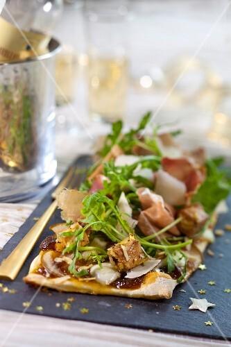 Pear,mozzarella, foie gras, prosciutto ,hazelnut and fig chutney Christmas pizza