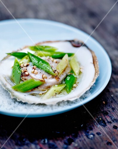 Flat oyster with hazelnut oil,sliced spring onion stalks and white pepper