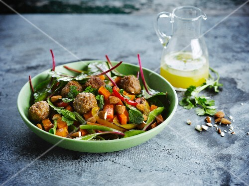 Carrot and pepper salad with veal,almond,orange and coriander meatballs