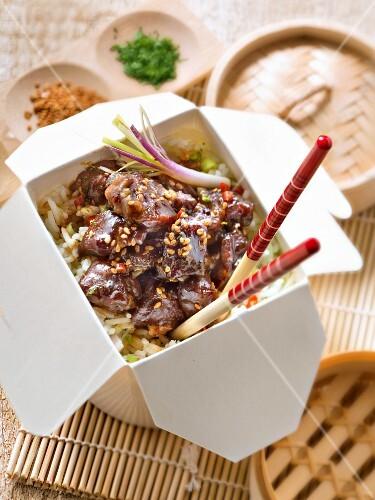Caramelzed pork withsesame seeds,jasmin-flavored rice