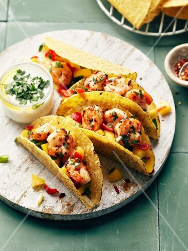 Shrimp,red and yellow pepper tacos,yoghurt and herb sauce