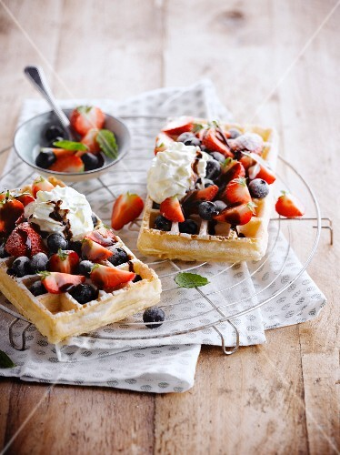 Brussels waffles with red berries and cream