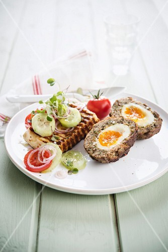Scotch eggs with baked cheese