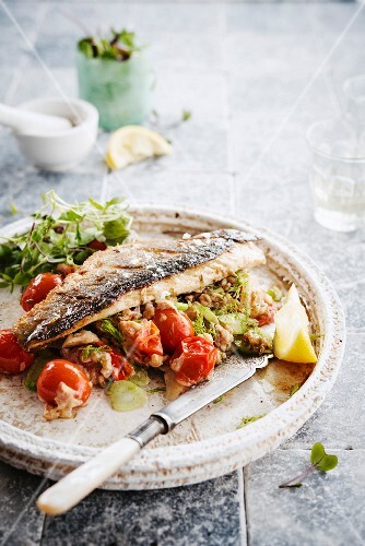 Grilled sea bass with tomato, fennel and wheat