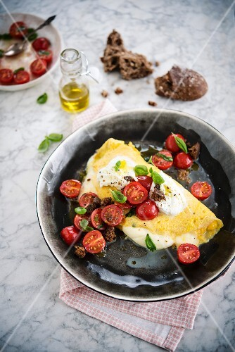 OOmelet with mozzarella and cherry tomato salad