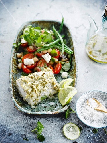 Piece of cod with lemon,green bean and white haricot bean salad tomatoes and goat's cheese