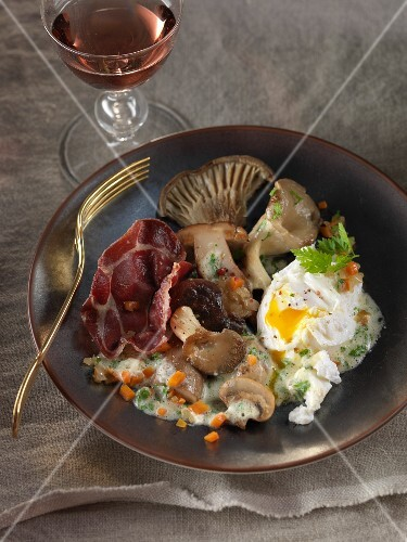 Pan-fried mushrooms,herb cream,coppa crisps and a poached egg