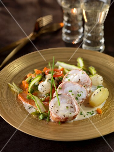 Roasted monkfish wrapped in bacon,pan-fried vegetables and potatoes
