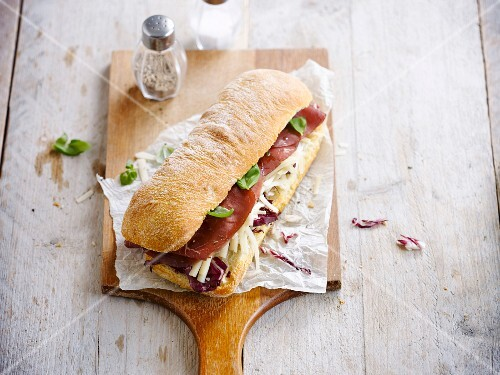 Grisons meat,grated cheese and radicchio ciabatta bread sandwich