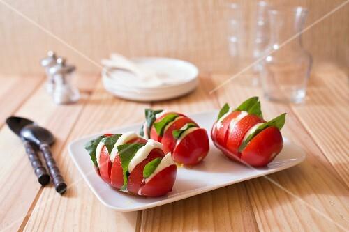 Hasselback potato-style tomatoes with mozzarella and basil