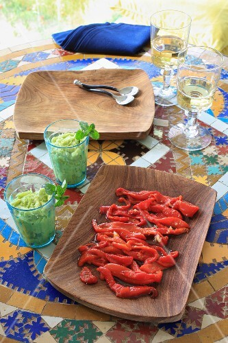 Féroce d'avocat (avocado with stockfish, French Antilles) and peeled, marinated peppers