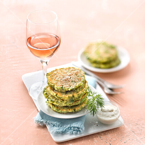 Herb cakes with garlic cream and a glass of Bordeaux Rosé