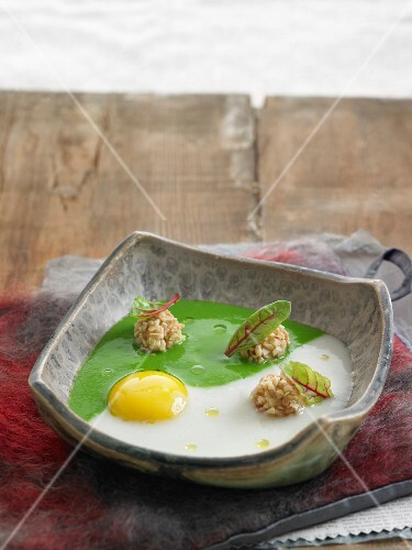 An egg yolk with chard cream