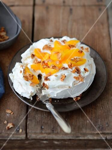 Peach and caramelized thinly sliced almond Pavlova