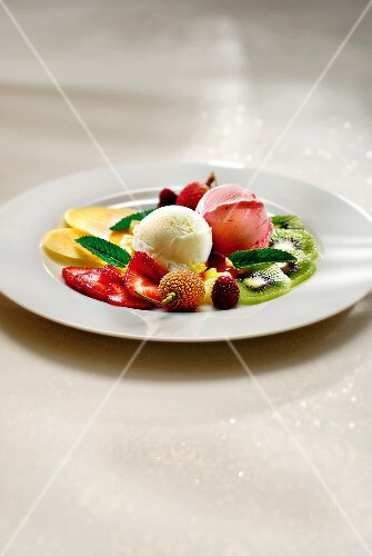 Plate of fresh fruit and scoops of sorbet