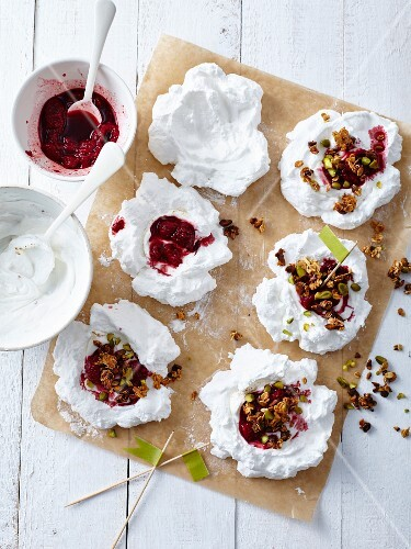 Meringues with raspberry coulis,caramelized oat flakes and pistachios