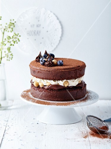 Chocolate cake with ganache,whipped cream and hazelnut filling